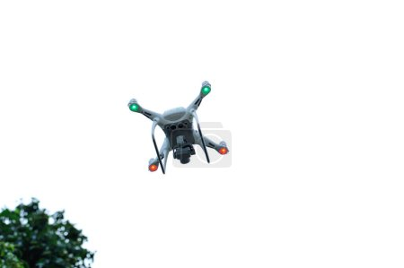 Photo for White drone with camera flying taking pictures of lychee frutis in summer - Royalty Free Image