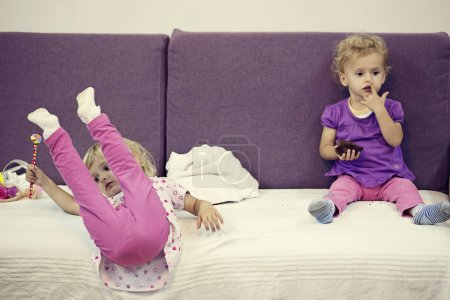 Photo for Two children playing at home with toys - Royalty Free Image