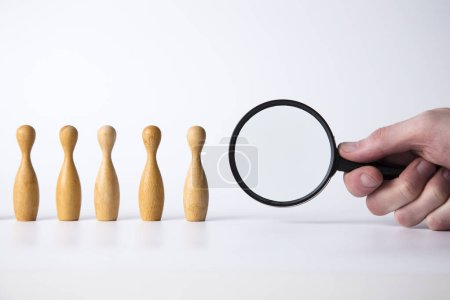 Photo for Recruitment concept. Magnifying glass with wooden people. Talent, Job, Opportunity concept - Royalty Free Image