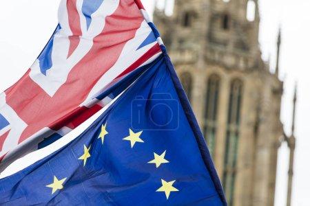 Photo for European Union and British Union Jack flag flying together. - Royalty Free Image