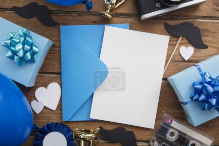 Photo for Fathers day blank card background surrounded by presents and gifts - Royalty Free Image