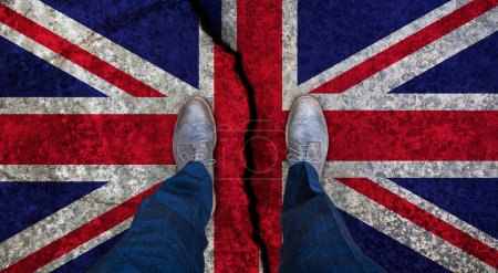 Business man standing on cracked flag of United Kingdom. Brexit concept