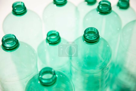 Photo for Empty used green plastic water bottles for recycling. environment concept - Royalty Free Image