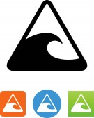 A warning sign with a large wave / tidal wave icon