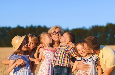 Photo for Portrait of kissing family at sunset - Royalty Free Image