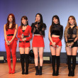 Members of South Korean girl group Laboum attend a...