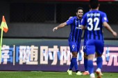 Italian-Brazilian football player Eder Citadin Martins of Jiangsu Suning celebrates with his teammates after scoring a goal against Beijing Renhe in their 27th round match during the 2018 Chinese Football Association Super League (CSL) in Beijing, Ch