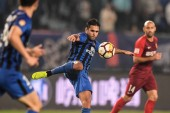 Italian-Brazilian football player Eder Citadin Martins, simply known as Eder, of Jiangsu Suning shots the ball against Hebei China Fortune in their 28th round match during the 2018 Chinese Football Association Super League (CSL) in Nanjing city, east