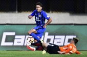 Italian-Brazilian football player Eder Citadin Martins of Jiangsu Suning, upper, dribbles against Beijing Renhe in their 27th round match during the 2018 Chinese Football Association Super League (CSL) in Beijing, China, 27 October 2018