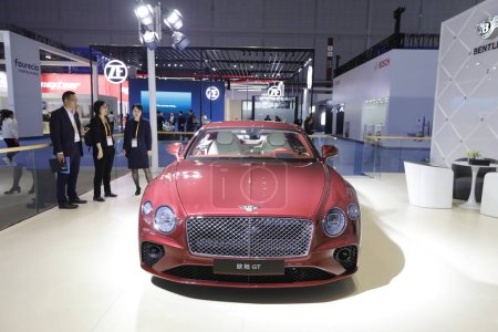 Visitors view a Bentley Continental