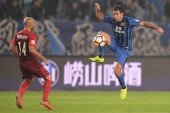 Italian-Brazilian football player Eder Citadin Martins, simply known as Eder, right, of Jiangsu Suning passes the ball against Argentine football player Javier Mascherano of Hebei China Fortune in their 28th round match during the 2018 Chinese Footba