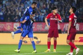 Italian-Brazilian football player Eder Citadin Martins, simply known as Eder, right, of Jiangsu Suning celebrates with Brazilian football player Alex Teixeira after scoring against Hebei China Fortune in their 28th round match during the 2018 Chinese