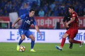 Italian-Brazilian football player Eder Citadin Martins, simply known as Eder, left, of Jiangsu Suning passes the ball against Uzbek football player Odil Ahmedov of Shanghai SIPG in their 26th round match during the 2018 Chinese Football Association S