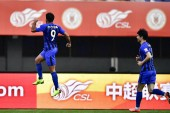 Italian-Brazilian football player Eder Citadin Martins of Jiangsu Suning, left, celebrates after scoring a goal against Beijing Renhe in their 27th round match during the 2018 Chinese Football Association Super League (CSL) in Beijing, China, 27 Octo