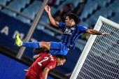 Italian-Brazilian football player Eder Citadin Martins, simply known as Eder, top, of Jiangsu Suning challenges a player of Shanghai SIPG in their 26th round match during the 2018 Chinese Football Association Super League (CSL) in Nanjing city, east