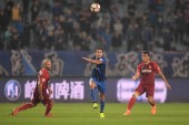 Italian-Brazilian football player Eder Citadin Martins, simply known as Eder, center, of Jiangsu Suning passes the ball against players of Hebei China Fortune in their 28th round match during the 2018 Chinese Football Association Super League (CSL) i