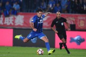 Italian-Brazilian football player Eder Citadin Martins, simply known as Eder, of Jiangsu Suning dribbles against Shanghai SIPG in their 26th round match during the 2018 Chinese Football Association Super League (CSL) in Nanjing city, east China's Jia