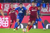 Italian-Brazilian football player Eder Citadin Martins, simply known as Eder, left, of Jiangsu Suning passes the ball against a player of Hebei China Fortune in their 28th round match during the 2018 Chinese Football Association Super League (CSL) in
