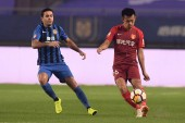 Italian-Brazilian football player Eder Citadin Martins, simply known as Eder, left, of Jiangsu Suning challenges a player of Hebei China Fortune in their 28th round match during the 2018 Chinese Football Association Super League (CSL) in Nanjing city