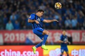 Italian-Brazilian football player Eder Citadin Martins, simply known as Eder, of Jiangsu Suning heads the ball against Shanghai SIPG in their 26th round match during the 2018 Chinese Football Association Super League (CSL) in Nanjing city, east China