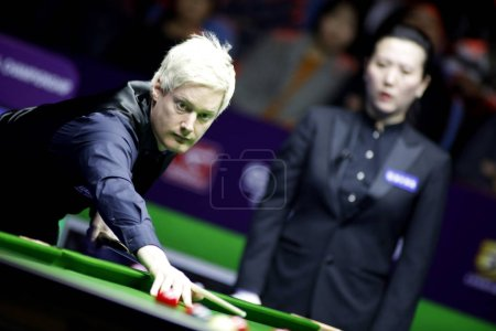 Photo for Neil Robertson of Australia considers a shot to Mark Selby of England in their quarterfinal match during the 2018 OPPO International Championship snooker tournament in Daqing city, northeast China's Heilongjiang province, 1 November 2018 - Royalty Free Image