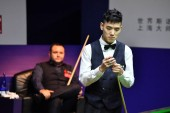 Pu Qingsong of China chalks his cue as he considers a shot to Stephen Maguire of Scotland in their first round match during the 2018 Shanghai Masters snooker tournament in Shanghai, China, 10 September 2018