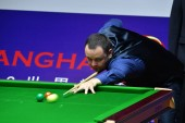 Stephen Maguire of Scotland plays a shot to Pu Qingsong of China in their first round match during the 2018 Shanghai Masters snooker tournament in Shanghai, China, 10 September 2018