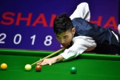 Pu Qingsong of China plays a shot to Stephen Maguire of Scotland in their first round match during the 2018 Shanghai Masters snooker tournament in Shanghai, China, 10 September 2018