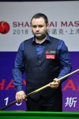 Stephen Maguire of Scotland considers a shot to Pu Qingsong of China in their first round match during the 2018 Shanghai Masters snooker tournament in Shanghai, China, 10 September 2018