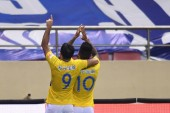 Brazilian football player Alex Teixeira, right, of Jiangsu Suning celebrates with his teammate Italian-Brazilian football player Eder Citadin Martins after scoring a goal against Shanghai Greenland Shenhua in their 22nd round match during the 2018 Ch