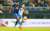 Italian-Brazilian football player Eder Citadin Martins of Jiangsu Suning, left, challenges a player of TianjinTEDA in their 19th round match during the 2018 Chinese Football Association Super League (CSL) in Tianjin, China, 18 August 2018