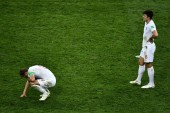 Harry Kane, left, and Harry Maguire of England react after they were defeated by Croatia in their semifinal match during the 2018 FIFA World Cup in Moscow, Russia, 11 July 2018.