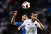 Bernardo Silva of Portugal, front, heads the ball against Matias Vecino of Uruguay in the round of 16 match between Uruguay and Portugal during the 2018 FIFA World Cup in Sochi, Russia, 30 June 2018