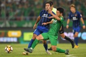 Italian-Brazilian football player Eder Citadin Martins of Jiangsu Suning, left, challenges a player of Beijing Sinobo Guoan in their 17th round match during the 2018 Chinese Football Association Super League (CSL) in Beijing, China, 10 August 2018.