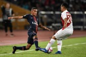 Rimane Kevin of Paris Saint-Germain, left, challenges Rony Lopes of Association Sportive de Monaco FC in the Trophee des Champions 2018 in Shenzhen city, south China's Guangdong province, 4 August 2018