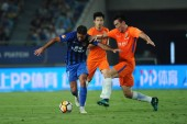 Italian-Brazilian football player Eder Citadin Martins, simply known as Eder, left, of Jiangsu Suning passes the ball against players of Shandong Luneng Taishan in their 14th round match during the 2018 Chinese Football Association Super League (CSL)