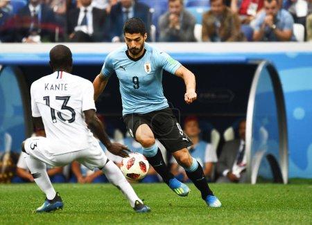 Luis Suarez right of Uruguay