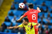 Harry Maguire of England, back, heads the ball against Carlos Bacca of Columbia in their Round of 16 match during the 2018 FIFA World Cup in Moscow, Russia, 3 July 2018