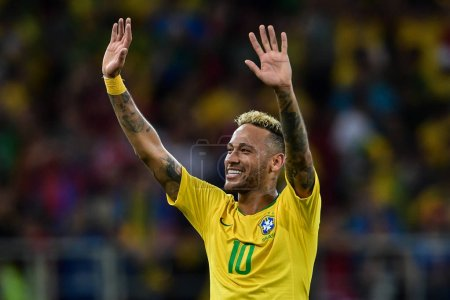 Neymar of Brazil greets fans