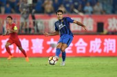 Italian-Brazilian football player Eder Citadin Martins of Jiangsu Suning dribbles against Chongqing SWM in their 18th round match during the 2018 Chinese Football Association Super League (CSL) in Nanjing city, east China's Jiangsu province, 15 Augus