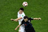 Harry Maguire of England, left, challenges Milan Badelj of Croatia in their semifinal match during the 2018 FIFA World Cup in Moscow, Russia, 11 July 2018.