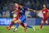 Italian-Brazilian football player Eder Citadin Martins dribbles against Chongqing SWM in their 18th round match during the 2018 Chinese Football Association Super League (CSL) in Nanjing city, east China's Jiangsu province, 15 August 2018