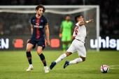 Rony Lopes of Monaco, right, falls after being fouled by Adrien Rabiot of Paris Saint-Germain during Trophee des Champions 2018 in Shenzhen city, south China's Guangdong province, 4 August 2018.