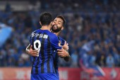 Brazilian football player Alex Teixeira, behind, of Jiangsu Suning celebrates with his teammate Italian-Brazilian football player Eder Citadin Martins after scoring a goal against Guangzhou R&F in their 20th round match during the 2018 Chinese Footba