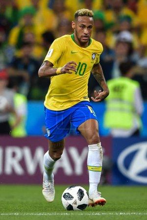 Neymar of Brazil dribbles against