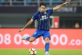 Italian-Brazilian football player Eder Citadin Martins of Jiangsu Suning kicks the ball to shoot against TianjinTEDA in their 19th round match during the 2018 Chinese Football Association Super League (CSL) in Tianjin, China, 18 August 2018