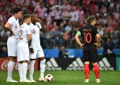 (From left) Harry Maguire, Kieran Trippier and Ashley Young of England prepare for a free kick next to Luka Modric of Croatia in their semifinal match during the 2018 FIFA World Cup in Moscow, Russia, 11 July 2018.