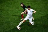 Harry Maguire of England, front, challenges Luka Modric of Croatia in their semifinal match during the 2018 FIFA World Cup in Moscow, Russia, 11 July 2018.