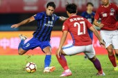 Italian-Brazilian football player Eder Citadin Martins of Jiangsu Suning, left, kicks the ball to shoot against Henan Jianye in their 15th round match during the 2018 Chinese Football Association Super League (CSL) in Zhengzhou city, central China's