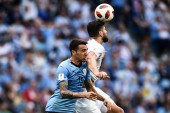 Olivier Giroud, top, of France heads the ball against Matias Vecino of Uruguay in their quarterfinal match during the 2018 FIFA World Cup in Nizhny Novgorod, Russia, 6 July 2018